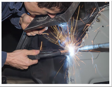 picture of welder repairing a car fender